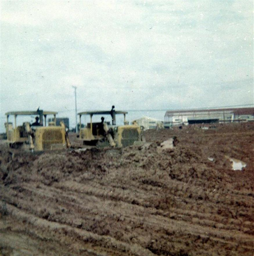 During some down time I walked over the hill to USARV where RMK-BRJ were working.  The two Vietnamese dozer operators had no clue how to move mud.I convinced them to let me show them the trick of buddy dozing.